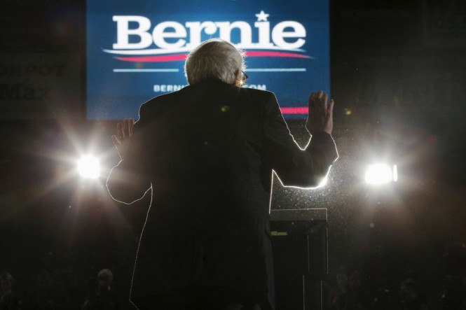 U.S. Democratic presidential candidate and U.S. Senator Bernie Sanders is silhouetted as he speaks at a campaign rally at UMass Amherst in Amherst, Massachusetts February 22, 2016. REUTERS/Brian Snyder - RTX2843C